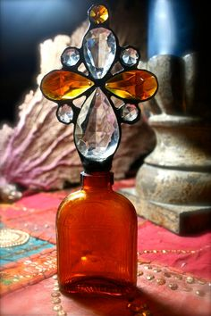 VIntage Cross Bottle, Amber and Clear Chandelier Crystal Clouds, Vintage Amber Spirits Flask Antique Perfume Bottles, Vintage Bottles, Amber Bottles, Glass Bottles, Sea Sculpture, Altered Bottles, Cross Designs, Bottle Art, Household Items