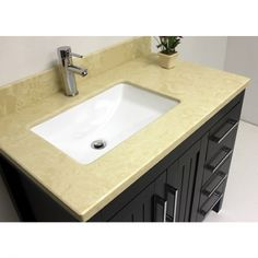 "36"" vanity with marble top and espresso solid wood. Has six compartments for lots of storage. Model vp033 Regular $799 Sale $499; faucet extra"