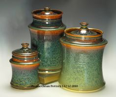 Nice set of pottery canisters, don't know the original potter.