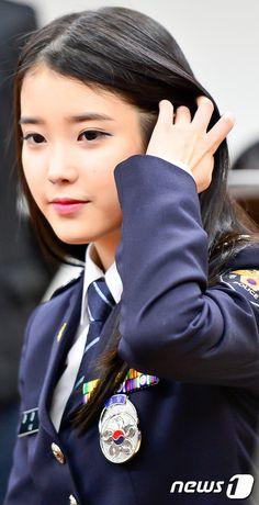Female celebrity in police uniform - Kpop star IU