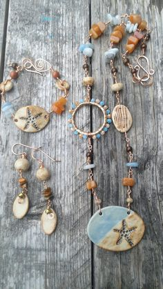Voting is now open. Stop by Firefly Dwain Studio Designer Challenge group on Facebook and vote for your favorite design. This set I used ceramic components from Firefly Design Studio, a polymer clay component by Teal Water Studio, crystals, gemstones, and copper wirework by me :)