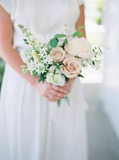 Time to break out the bubbly, because this classic garden inspired affair is worth toasting to. For not only did this darling duo utilize the SAME local designer (unbeknownst to them) for their wedding day looks, but they also managed to