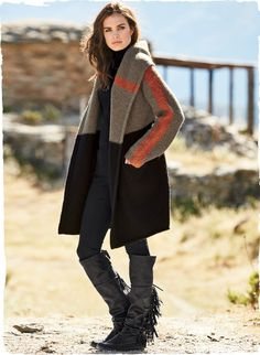 The perfect snuggle-up layer for winter, our felted knit coat is a soft embrace of plush alpaca (93%) and polyamide (7%). Colorblocked in taupe and black with burnt orange striping, it's scaled easy and oversized, with a deep hood, drop shoulders and pockets. The minimalist, buttonless silhouette is left unlined so you can feel the fiber's softness.