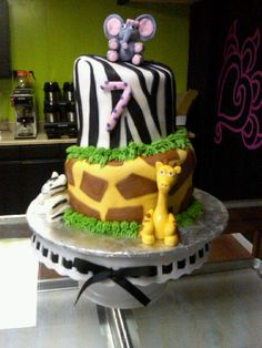 Love this cake, but maybe make the zebra print lavender and white and the giraffe print a teal and black.