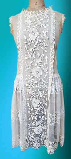 1920's Heavily Embroidered Lace Dress! SOOOOO much you can do with this dress!!! All gorgeous. There are drapy side panels and flouncy short sleeves.