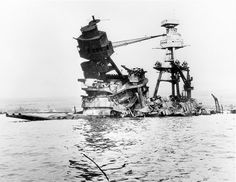 Exposed wreckage of the American battleship U.S.S. Arizona, most of which is now resting at the bottom of Pearl Harbor following a surprise Japanese attack on Dec. 7, 1941. (1942) [740x571]