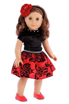 Perfect Holiday party dress from red taffeta with black velvet body with silver pearls at neckline with red shoes and matching headband. Doll dress contains a wide back closure for easy dressing and clothing removal. Our doll clothes fits 18 inch American Girl dolls. Designed in the USA and sold Exclusively by DreamWorld Collections. DOLL(S) NOT INCLUDED U.S. CPSIA CHILDREN'S PRODUCTS SAFETY CERTIFIED