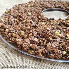 Simple and versatile chocolate chia granola recipe. Granola can be made raw using a dehydrator or baked int he oven.