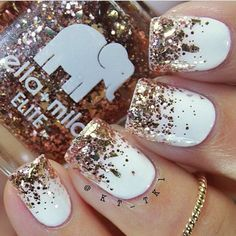 White Coat with Gold Sparkles Nail Design.