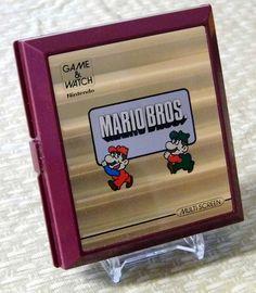 Vintage Nintendo Mario Bros. Game & Watch, Electronic Handheld Game, Model No. MW-56, Made in Japan, Copyright 1983.