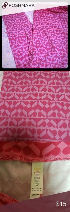 LuLaRoe Pink Heart Leggings TC Buttery soft leggings, perfect for Valentine's Day.  There is a very tiny, barely noticeable black mark near the bottom of the leggings, please see the last picture for details. LuLaRoe Pants Leggings