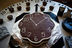 Bring out the Round the Clock theme with a clock cake.  Place on large platter and add numbers for the clock!