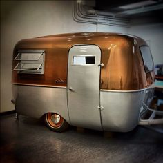 Copper top travel trailer.