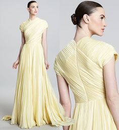 Stunning delicate yellow Carmen Marc Valvo cap sleeve high-neck gown. I think the intricate pleating really adds to the strong silhouette of this dress, and I think it would make a striking wedding gown.