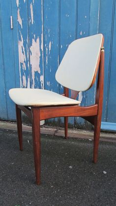 These beautiful teak chairs were designed and manufactured by Elliotts of Newbury in the late 70s. Manufactured in a classic Danish influenced design