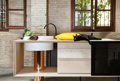 Mut Design created a mobile kitchen of wood, copper and marble