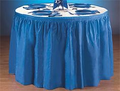 cheap table covers - be prettier if it was coral and ivory....
