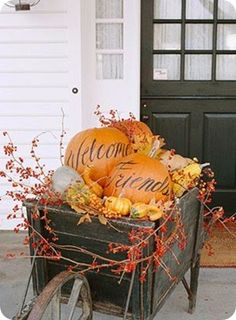 love this!  even just painting the pumpkins to say welcome is super cute! and the black wheelbarrow makes a great background colour for the display.