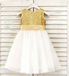 Sequin Little Girl Tutu Dress-Ivory Knee Length Gold Sequin Big Bow Back Flower Girl Dress Material: Tulle mesh, sequin, cotton, satin Available from 6 months - 14 years A matching sequin headband also come along with the dress Custom colors are available upon request Please do compare your little girl measurements with our size chart below before deciding her size or you may leave a note your little girl's height, bust and waist measurements so we can process it and send you the right size.