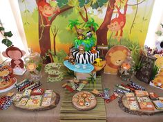 Incredible dessert table at a jungle baptism party! See more party ideas at CatchMyParty.com!