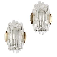 Pair of Sculptural French Glass and Brass Sconces | From a unique collection of antique and modern wall lights and sconces at https://www.1stdibs.com/furniture/lighting/sconces-wall-lights/