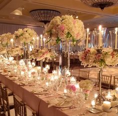 Love the alternating styles of tall blush and white centerpieces by Melony Rodwell