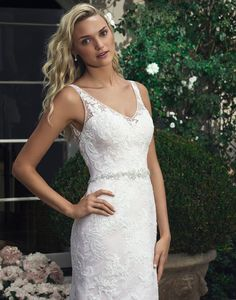 Crafted from the finest Devore Silk Chiffon, the Casablanca 2204 wedding dress will make your day extra special. This fit-and-flare style features beaded lace applique atop a tulle overlay. Sheer tank straps give way to a V-neckline. The natural waistline is belted with a beaded motif of Swarovski crystals, rhinestones, silver-backed sequins, and pearls. For the back, illusion lace is a sexy touch, while looped pearl buttons hide a center back zipper. The skirt finishes to a round sweep…