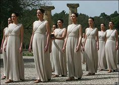 Greek actresses dressed in the costumes of priestesses from ancient Olympia, where the Olympics began in