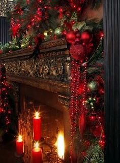 really like the red ornaments and the way they trail down the side of the mantle