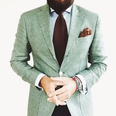 This mint sport coat, pale blue shirt and chocolate tie are a great color play.
