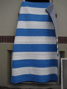 Simple nautical quilt. Can you see the back! Grey solid with strip of narrower blue and white
