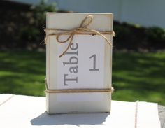 A personal favorite from my Etsy shop https://www.etsy.com/listing/234610009/white-table-number-holder-photo-holder