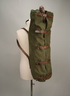 A vintage military leather & canvas large duffle bag.