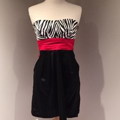 Black red white dress Satin black dress with red bodice and tie with zebra print sweetheart strapless bra top.  It has pleats in front that hide front pockets.  Worn once to an event. Wishes Wishes Wishes Dresses Strapless