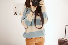 Thick blue and white stripes for a sweater paired with golden yellow pants.