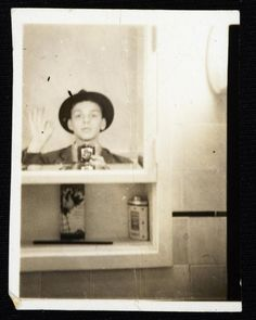 Ol' Blue Eyes taking a photo of himself in 1938 in his Hoboken apartment.