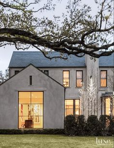 Gray stucco with minimal black trim...would like this one better with a metal roof actually love the exterior