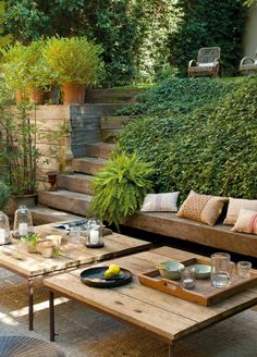 Multi-level garden with rustic timber furniture