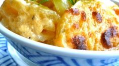 Thinly sliced potatoes and onion are layered in a creamy cheese sauce creating the perfect au gratin potato recipe.