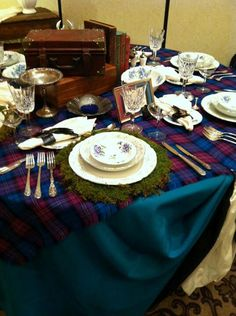 This carries over the mossy seating card theme. Just change to tartan and it will be perfect. (at least for the silverware and plate settings)