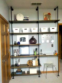 My DIY Plumbing Pipe Shelving Unit.  Click to find additional photos and directions.