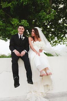 Bride and Groom. The Mansion at Tuckahoe in Jensen Beach FL. Stephen Janowski Nike SB Wedding shoes with Jack Rodgers monogrammed sandals as bride shoes