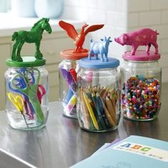 Cute idea! Glue plastic toys to lids and spray or paint for unique and colourful storage.