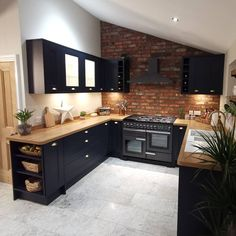 From exposed brickwork to navy kitchen cabinets, this Fairford Navy kitchen is packed with kitchen design inspiration. Pair the navy shaker ideas with wooden worktops and grey flooring ideas. Home Decor Kitchen, Interior Design Kitchen, New Kitchen, Brass Kitchen, Kitchen Oven, Kitchen Ideas, Kitchen Hardware, Kitchen Storage, Wooden Worktop Kitchen