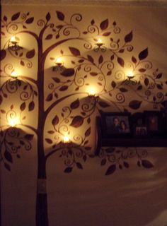 """Tree painted on the wall with candles mounted on the """"branches"""". LOVE!"""