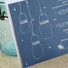 Fireflies and Mason Jars Wedding Invitation (White Ink) Elegant and whimsical in style this unique wedding invitation is perfect for an outdoor wedding with a rustic theme -- even a night ceremony and reception. Your one-of-a-kind wedding invite is white ink printed on a midnight blue shimmer paper -- gorgeous!