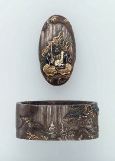 Fuchi-kashira with designs of Fudo sitting in front of a waterfall  Japanese, Edo Period, Late 18th–early 19th century  By Tetsugendo Naoshige, Japanese, died in 1780, MFA