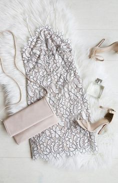 Pair a white and black lace dress with blush-colored accessories for the perfect date night look. Let Daily Dress Me help you find the perfect outfit for whatever the weather! dailydressme.com/