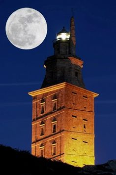 Tower of Hercules at night with full moon, World Heritage Site, roman lighthouse, La Corunna, Galicia, Spain