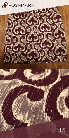 Ann Taylor Factory Ikat Print Skirt Beautiful skirt in excellent condition. Just not wearing it as much as I'd like to. 17.5x16.5, hits right at middle of the knee for on my 5'6 frame. Maroon/dark plum color with gray. Ann Taylor Skirts Mini